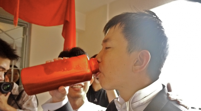 Man consuming beverage