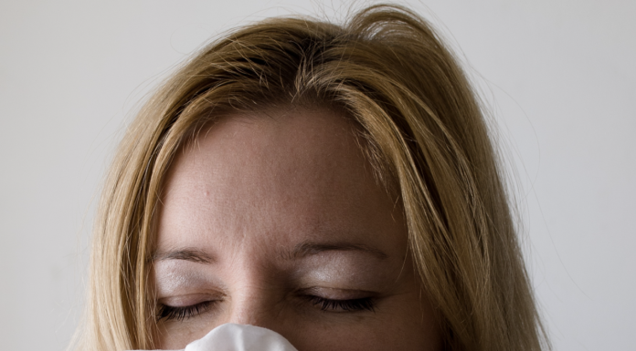 Woman with virus symptoms