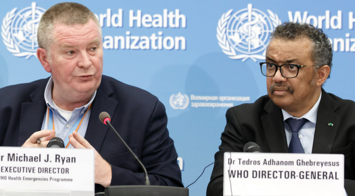 Michael Ryan, left, Executive Director of WHO's Health Emergencies programme, next to Tedros Adhanom Ghebreyesus, right, Director General of the World Health Organization (WHO)