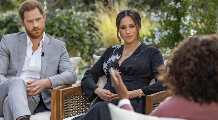 Prince Harry, left, and Meghan, Duchess of Sussex, in conversation with Oprah Winfrey