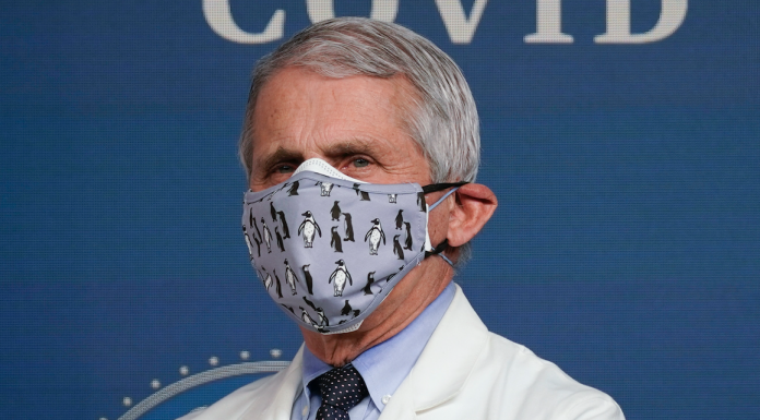 Dr. Anthony Fauci wearing two masks