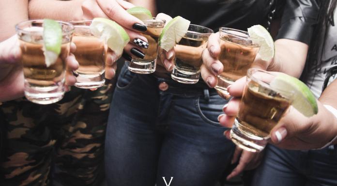 Women holding shot glasses