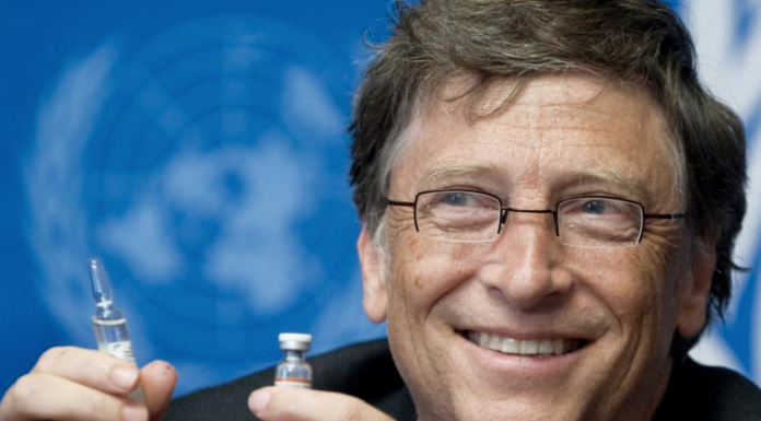 Bill Gates holding vaccine vile and needle