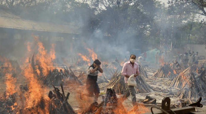 Funeral pyres of COVID-19 victims at a crematorium in the outskirts of New Delhi, India