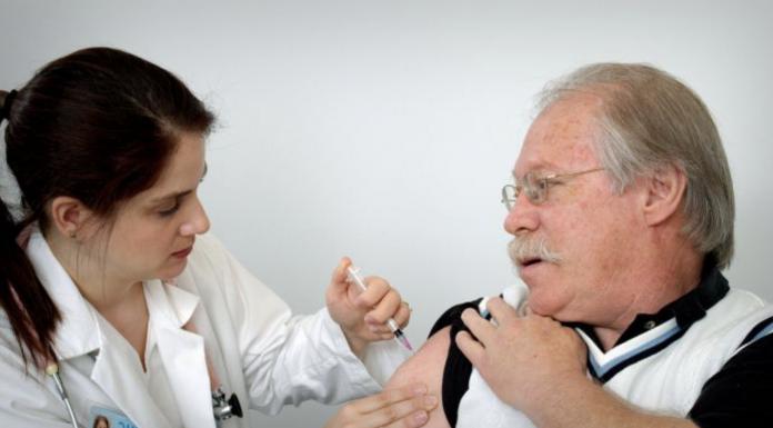 Man receiving vaccine