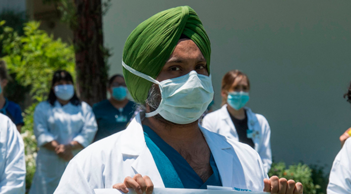 Doctors, nurses and other health care workers participate in a \